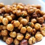 Close up of crispy chickpeas in a white bowl.