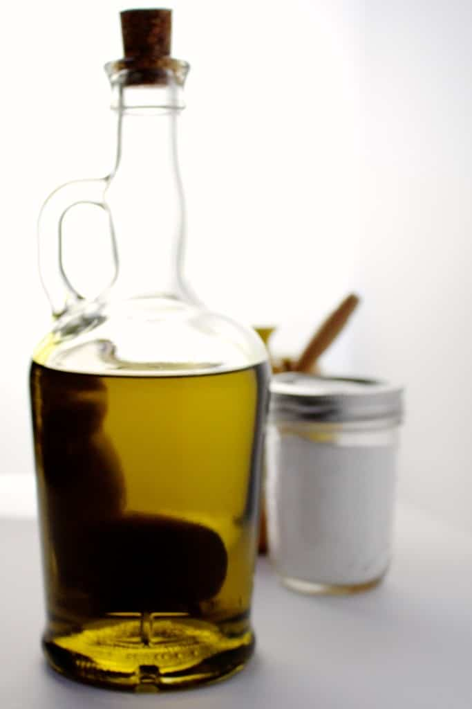 A glass carafe of olive oil on a counter.