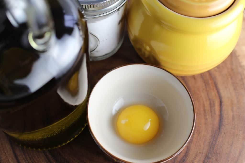 A single egg yolk in a small bowl.