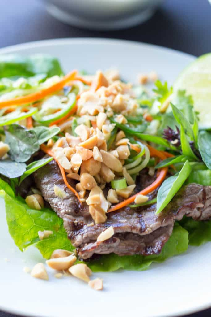 Close up of peanuts and veggies over Thai inspired beef in a lettuce wrap.