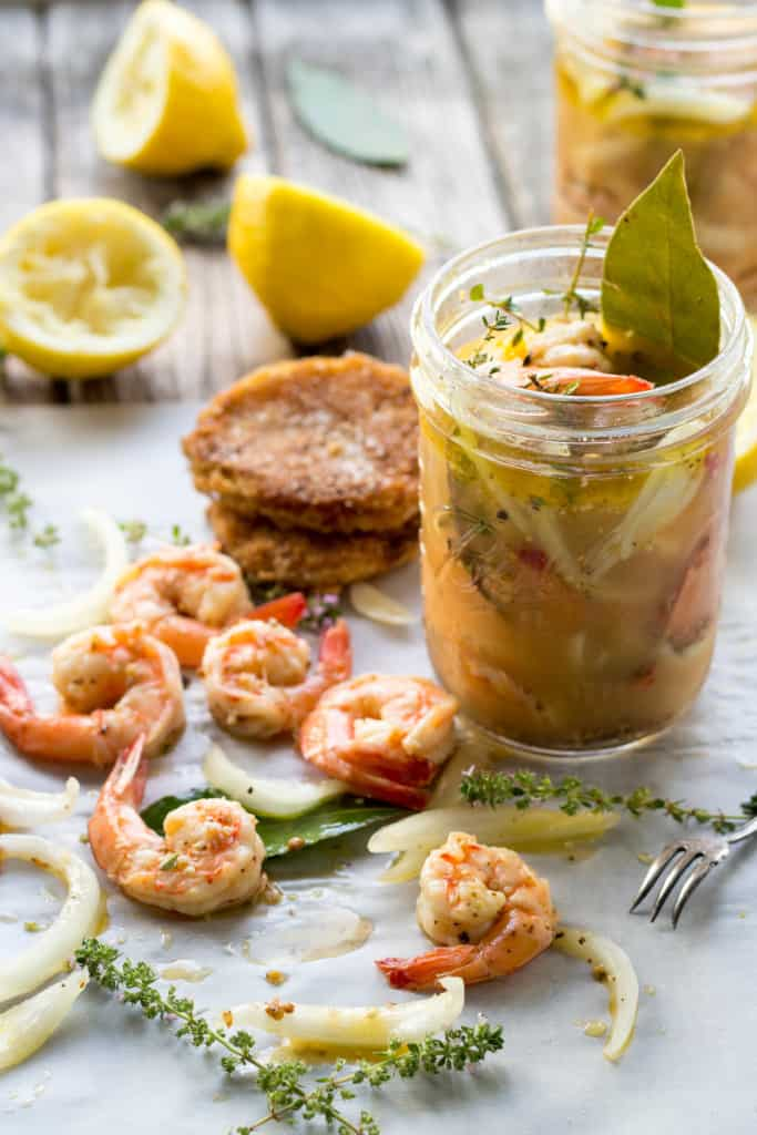 Shrimp and fried green tomatoes next to a jar of creole remoulade.