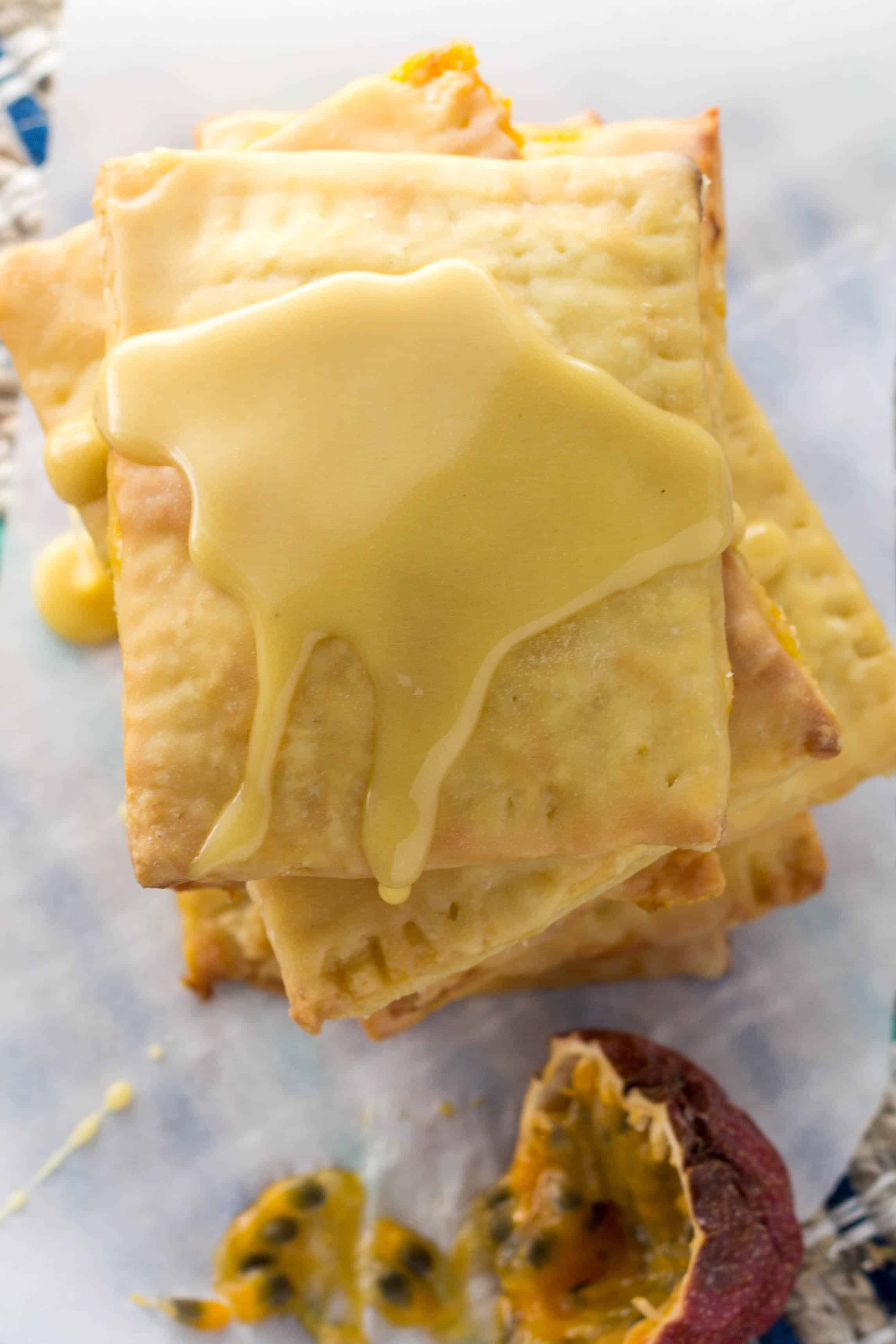 Top view of a stack of iced passion fruit pop tarts.