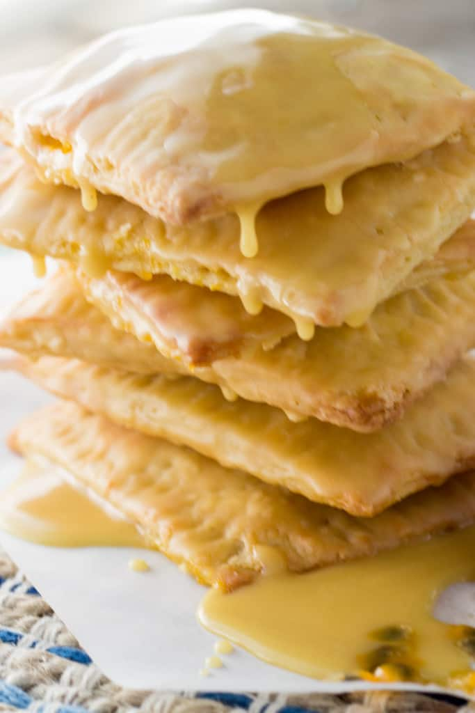 Side view of a stack of iced passion fruit pop tarts.