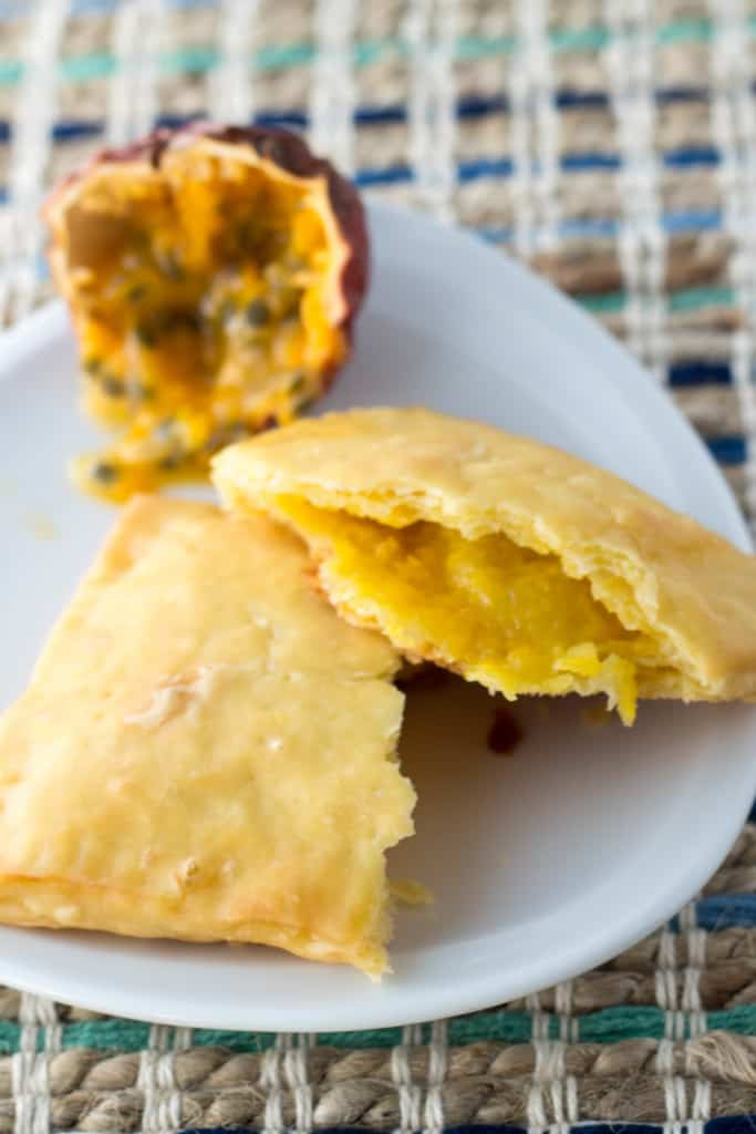 A homemade passion fruit pop tart split in half to see the filling.