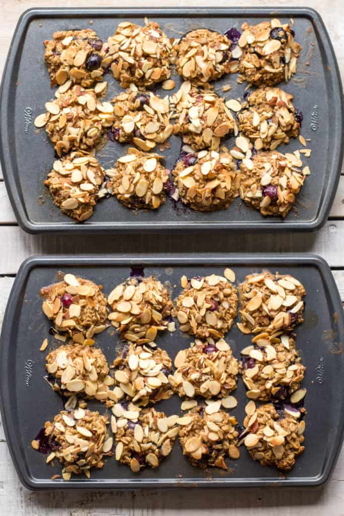 Two muffin tins filled with blueberry baked oatmeal cups.