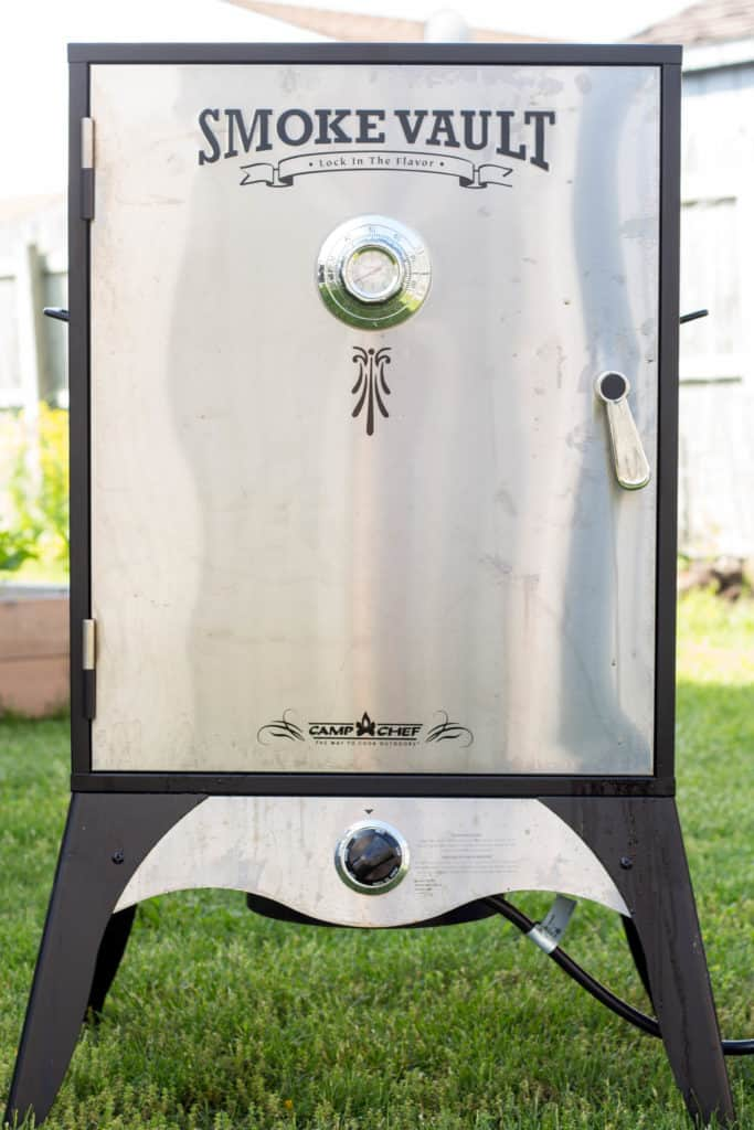 Front view of a cabinet style meat smoker.