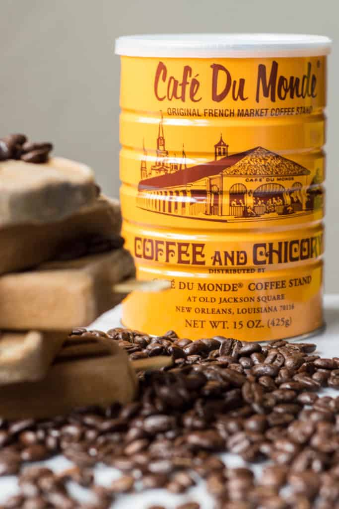 Close up of Cafe du Monde ground coffee next to some Vietnamese coffee popsicles.