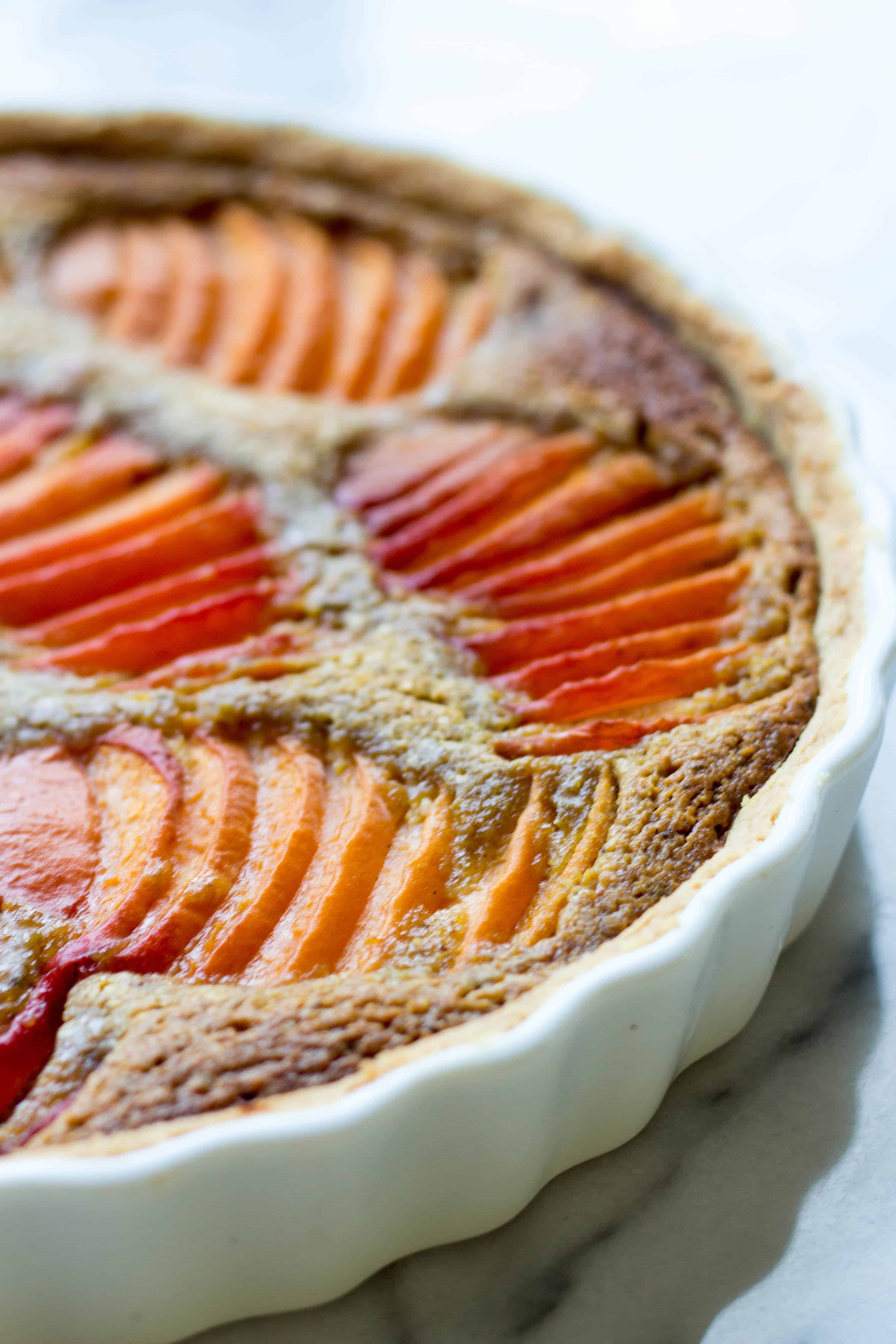 Close up of baked apricot pistachio tart.
