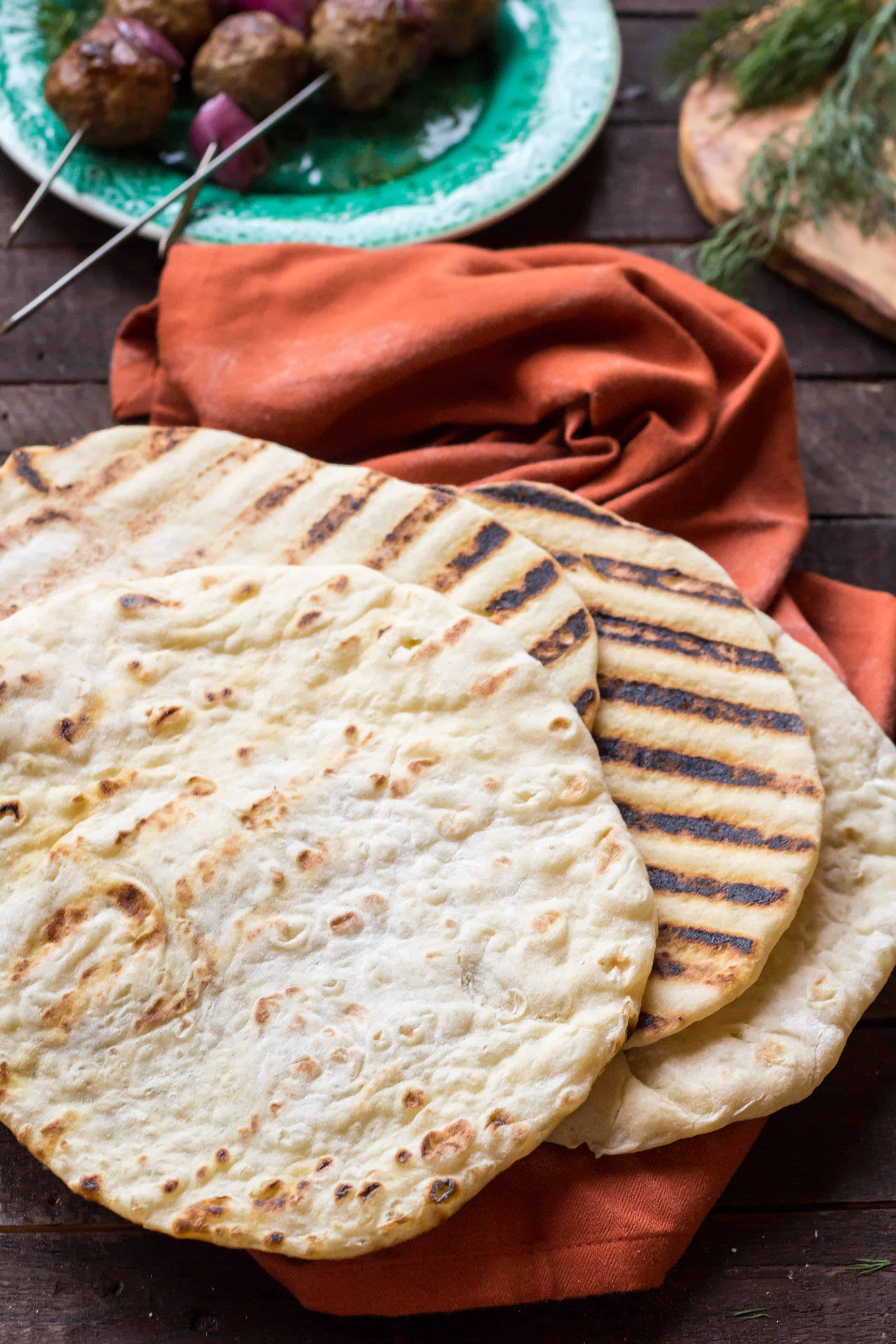Grilled pita bread on a red napkin.