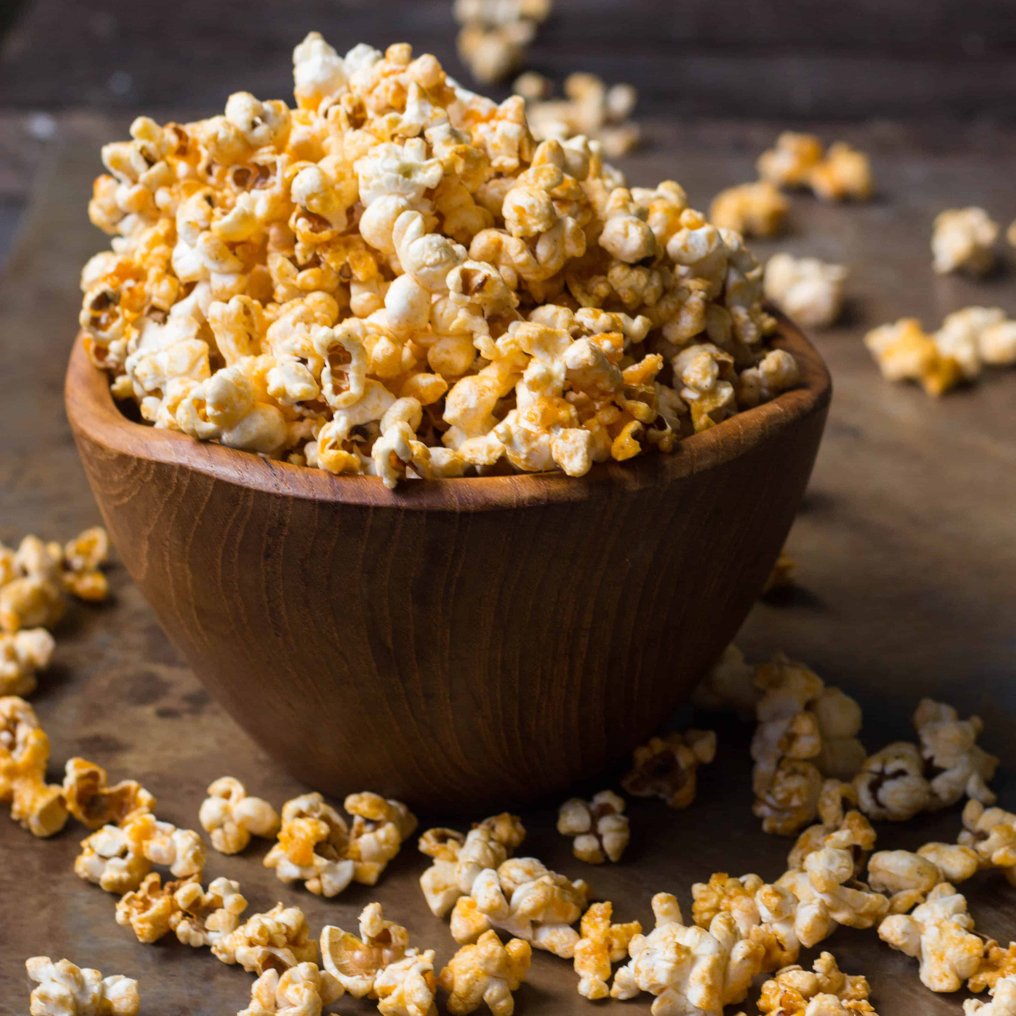 Popped corn in a small wooden bowl.
