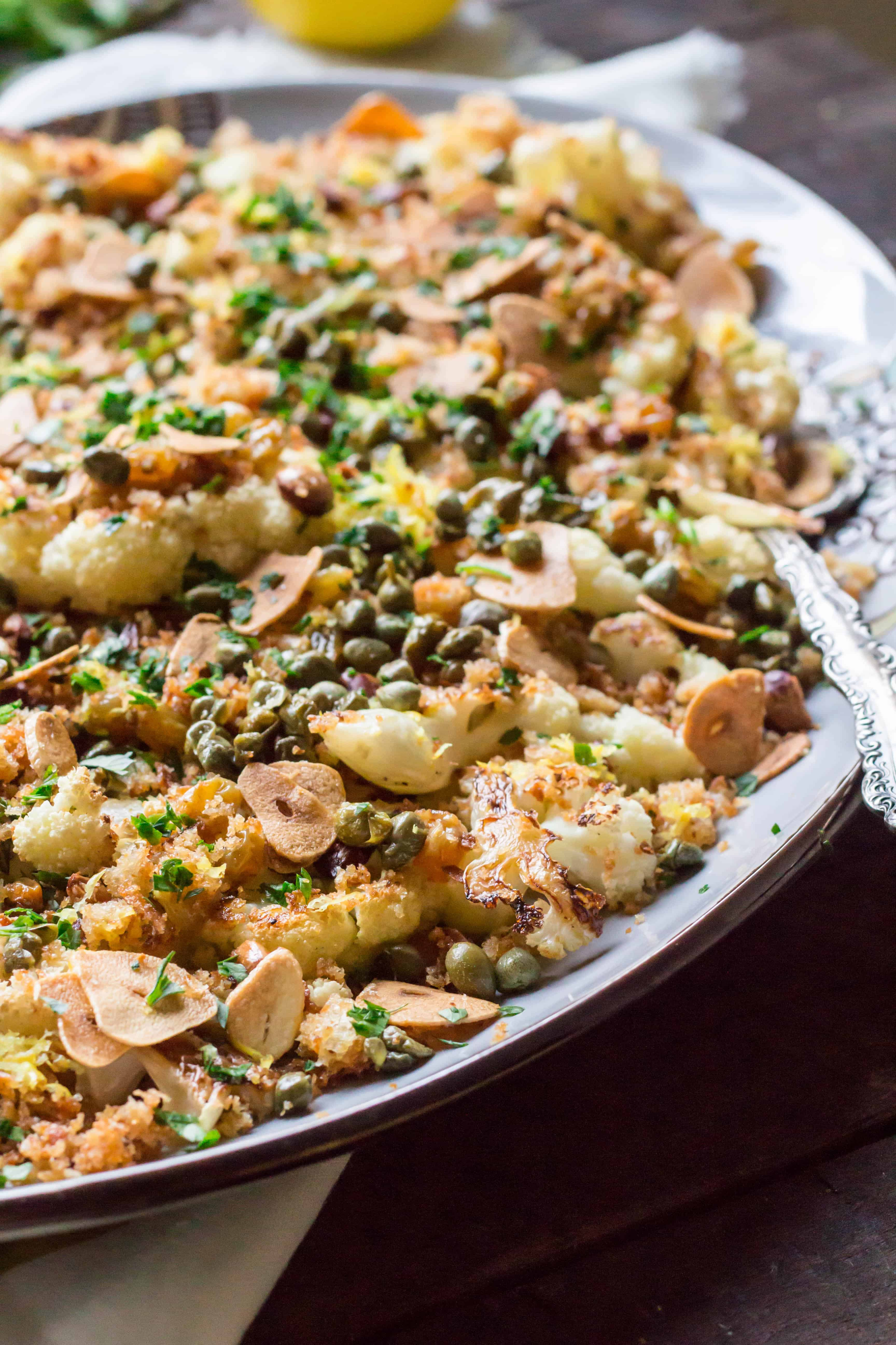 Close up of roasted cauliflower, toasted almonds, capers, and breadcrumbs.