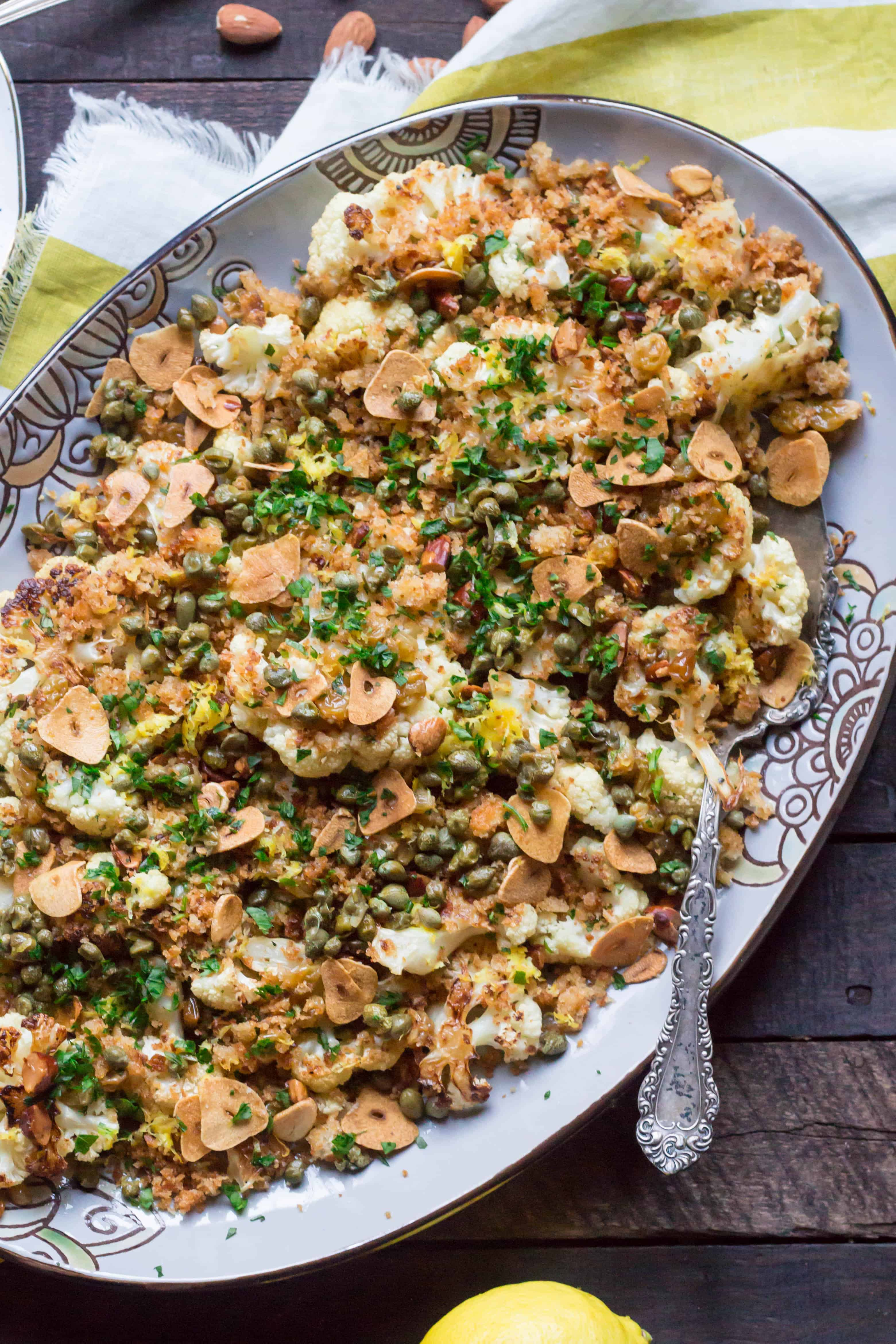 Oval serving platter of roasted cauliflower casserole.