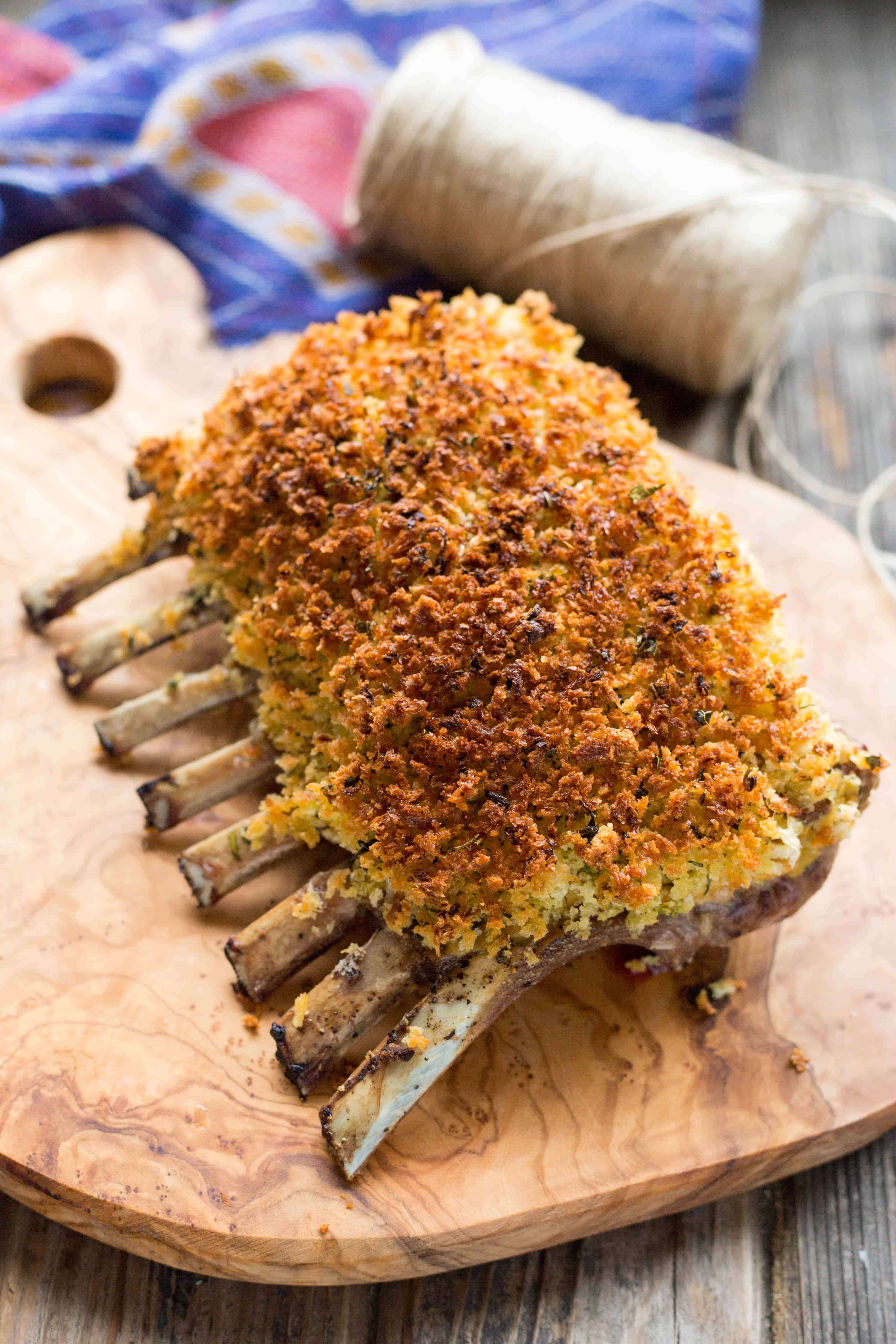 A rack of lamb coated with herb dijon and crusted in the oven.