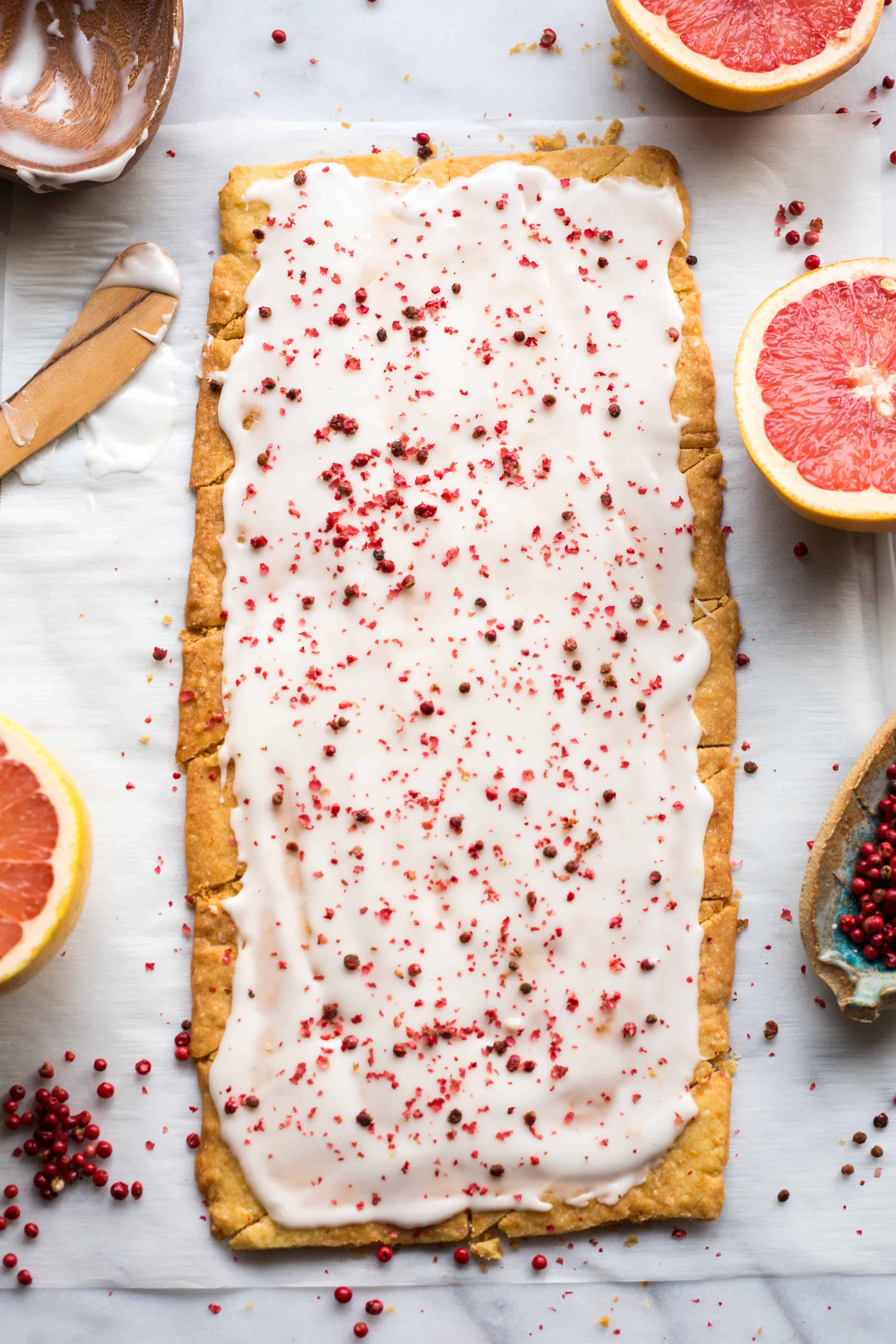 Rectangle of grapefruit shortbread that has been iced.