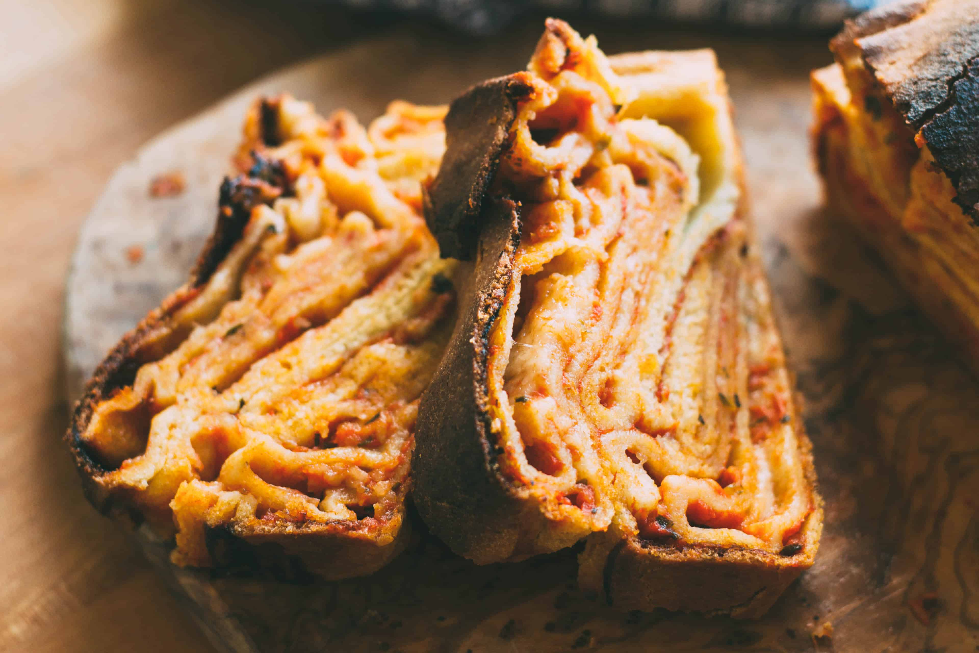 Thick slices of cooked pizza babka.