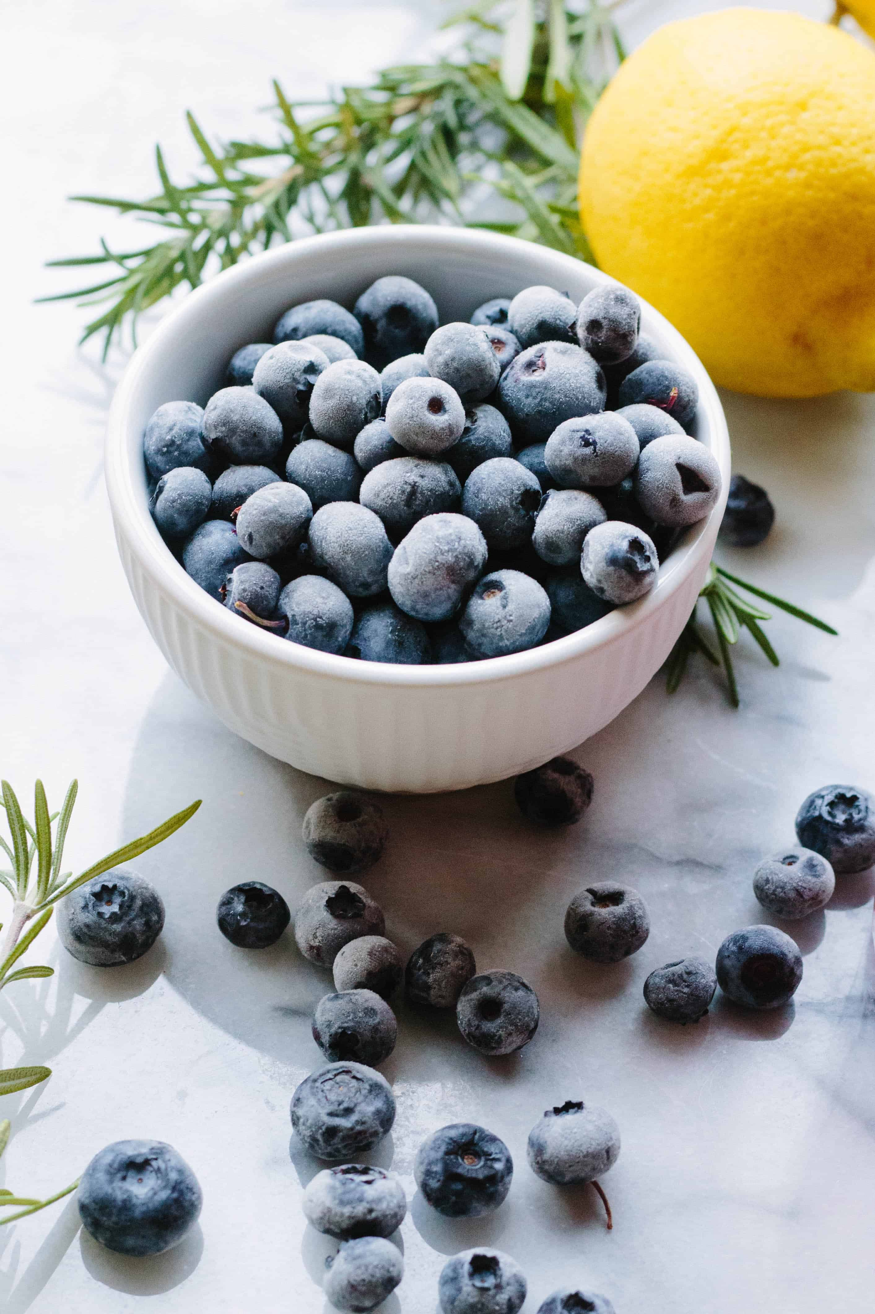 Small white bowl of fresh blueberries.