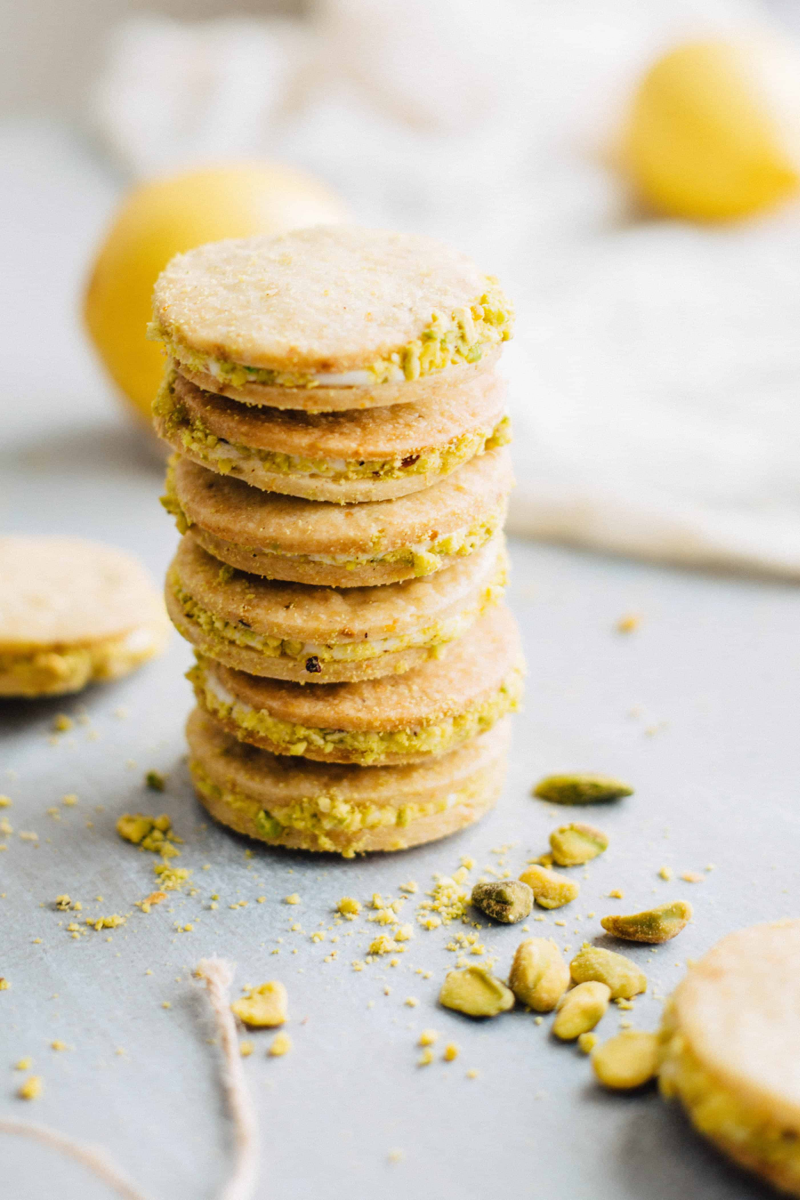 Vertical stack of six lemon pistachio sandwich cookies.