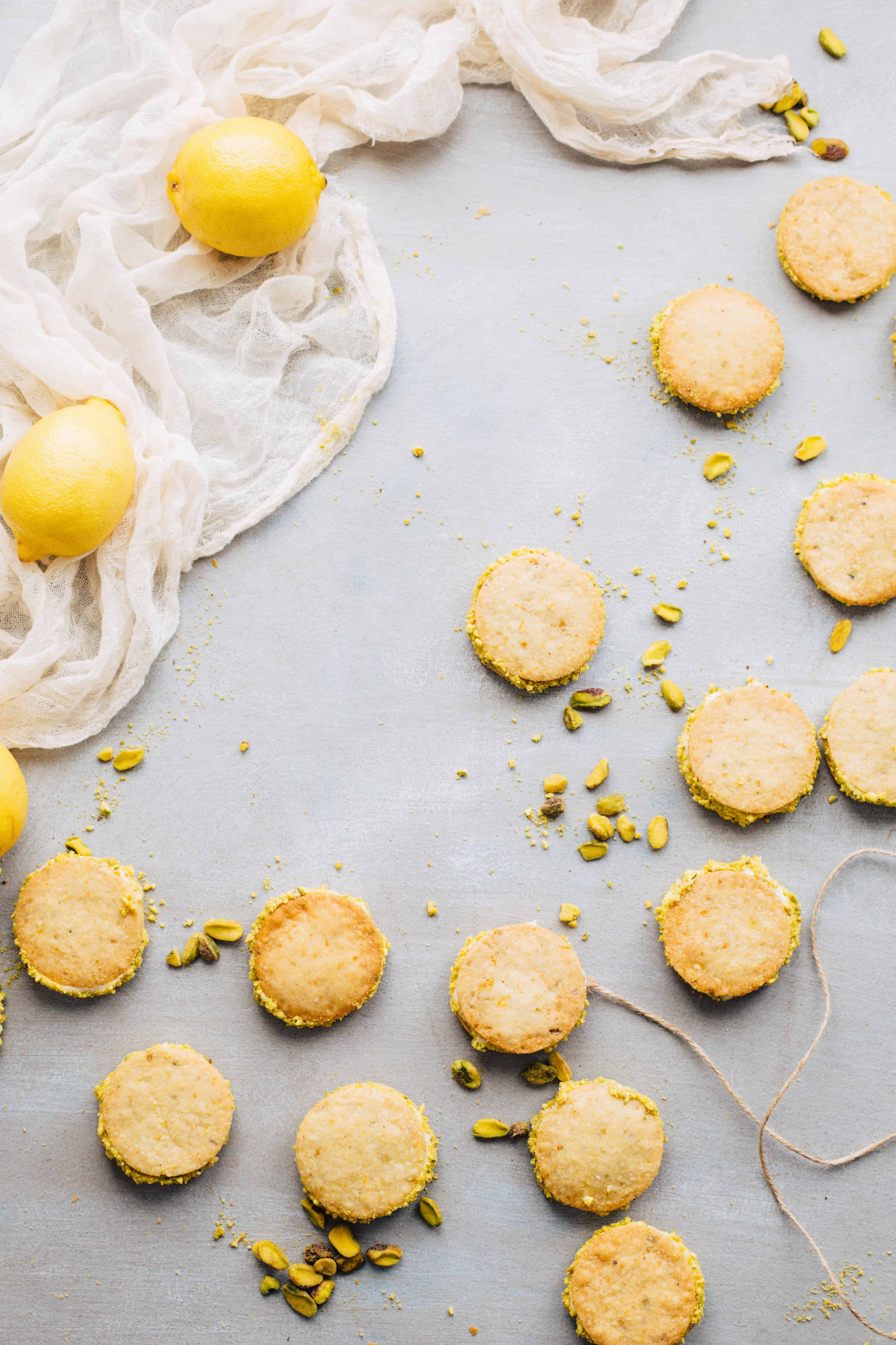 Top view of Meyer lemon pistachio cookies spread on a counter.