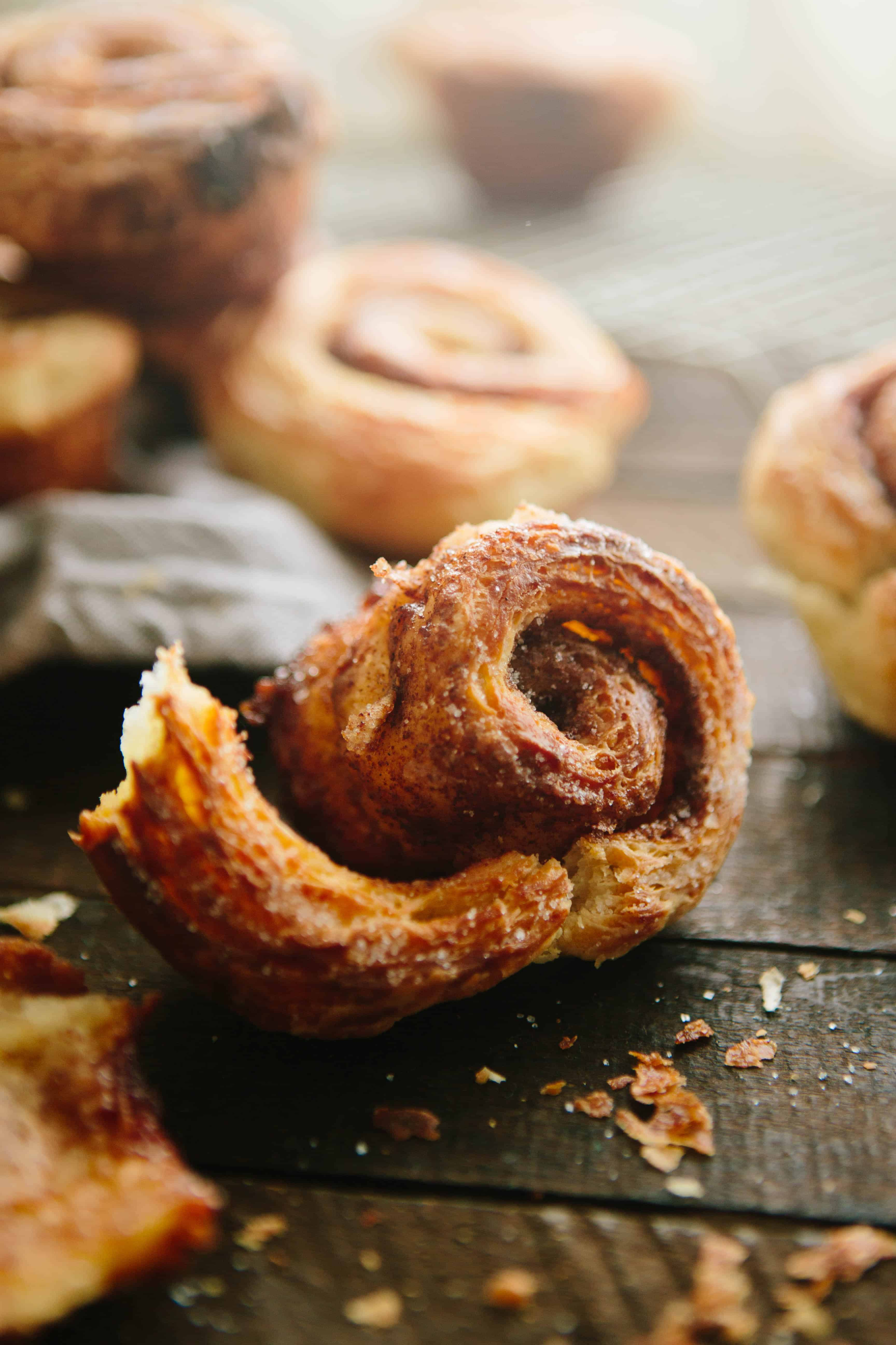 Close up of a croissant morning bun being unrolled.
