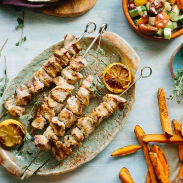 PORK KEBAB PITAS WITH TOUM | Tender Pitas Stuffed with Marinated Pork, Sweet Potato Fries, Tomato Cucumber Salad and a Garlicky Lebanese Sauce called Toum. | ColeyCooks.com