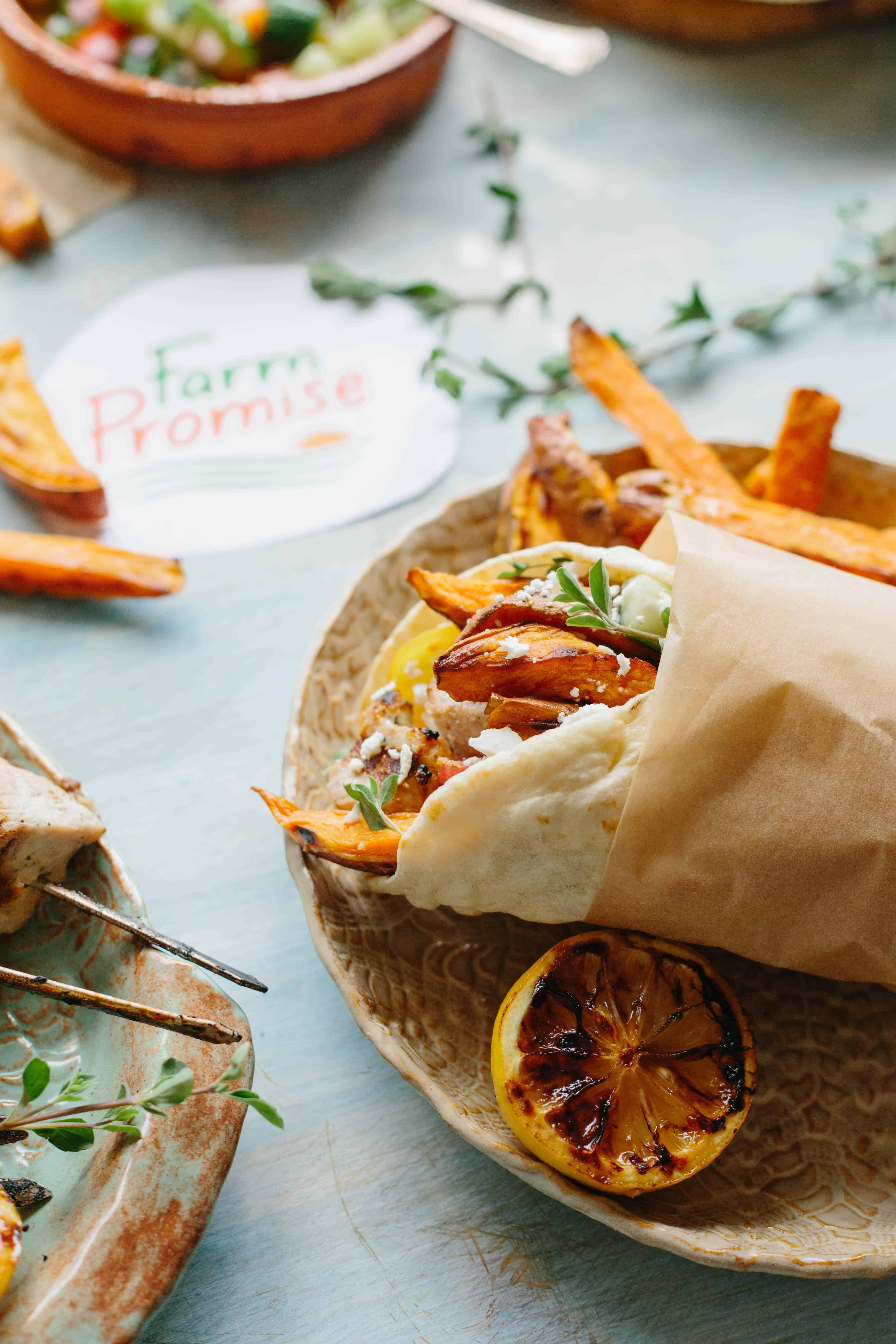 Pork and sweet potatoes wrapped up with salad in a pita.