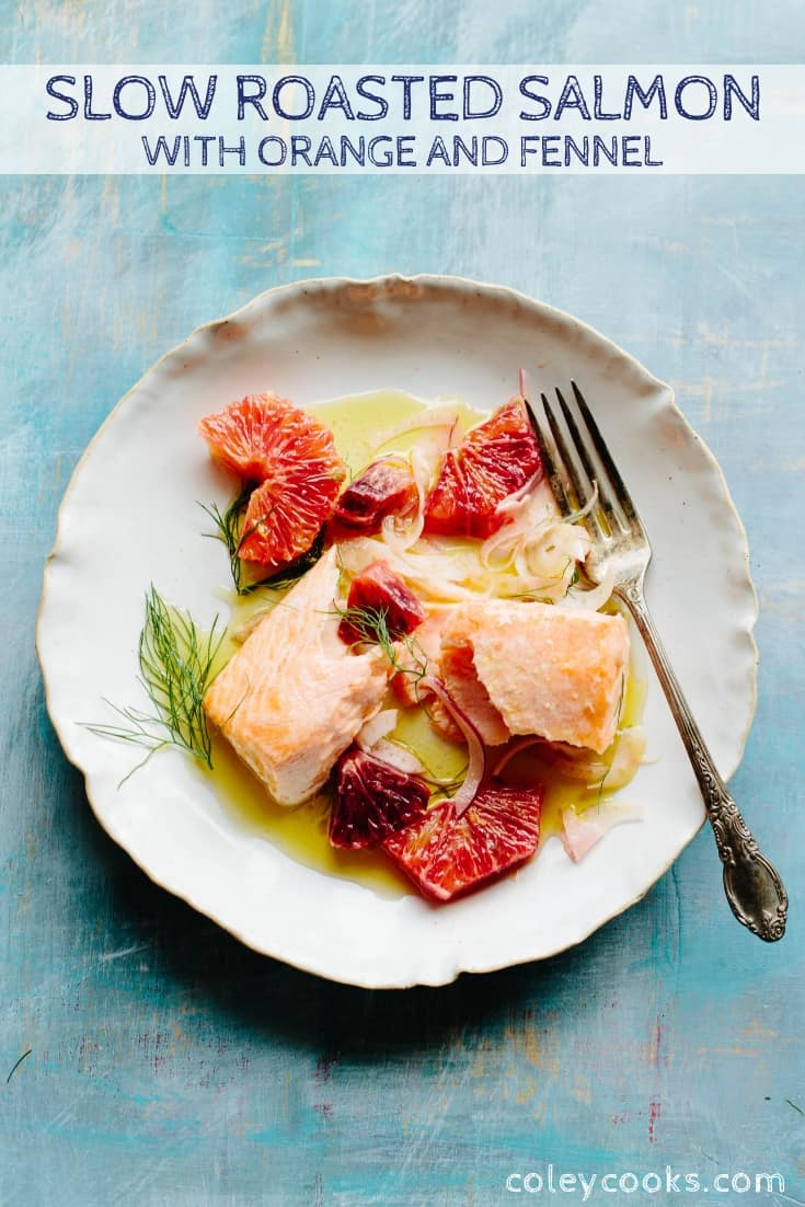 Top view of a white dinner plate with roasted citrus herb salmon.