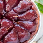 Top view of red wine poached pears baked in a tarte tatin.