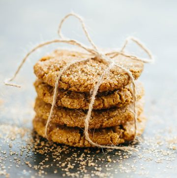 Four Brown Butter Ginger Molasses Cookies stacked and wrapped in twine