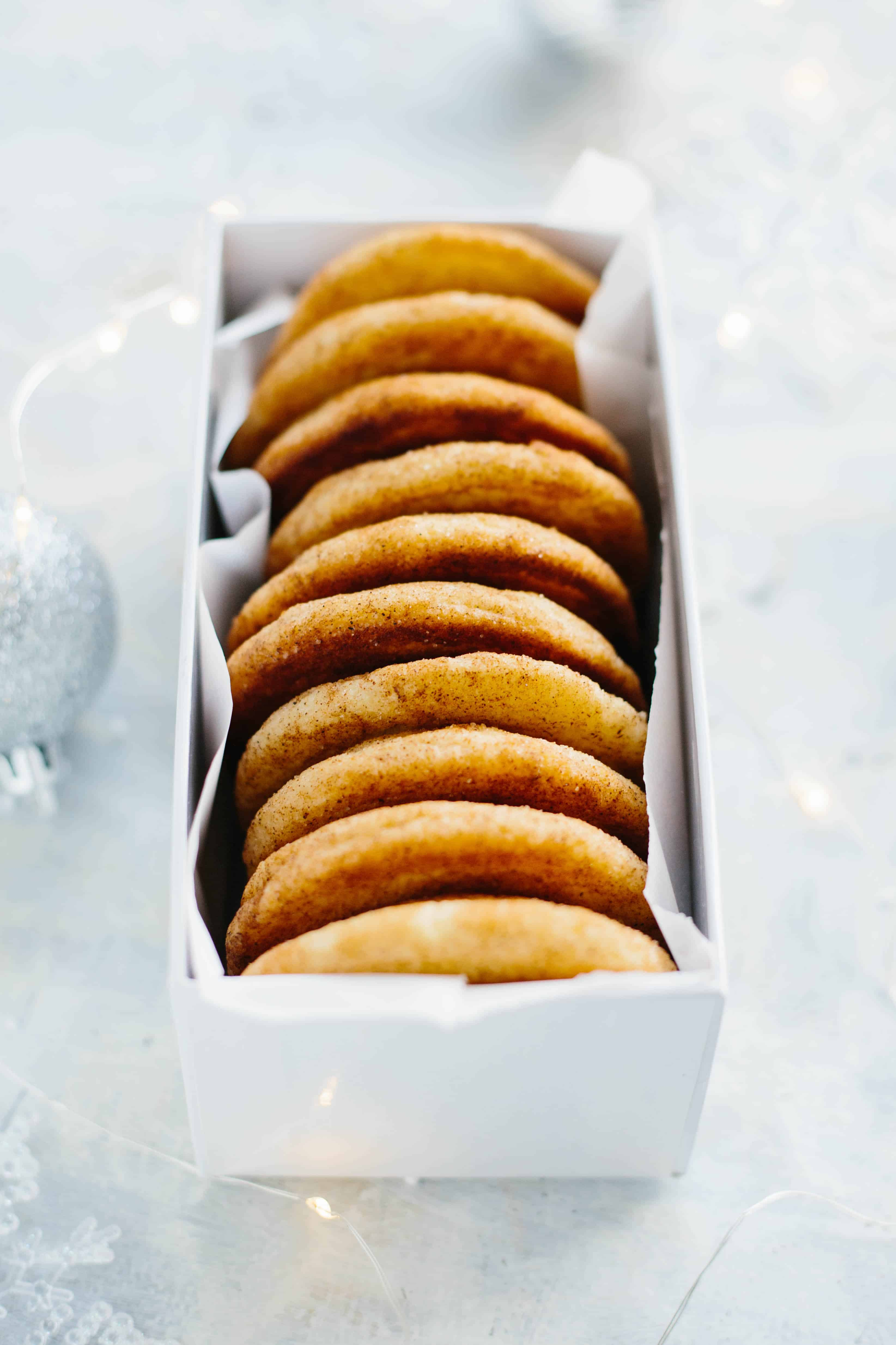 A gift box containing a row of snickerdoodle cookies stood on end.