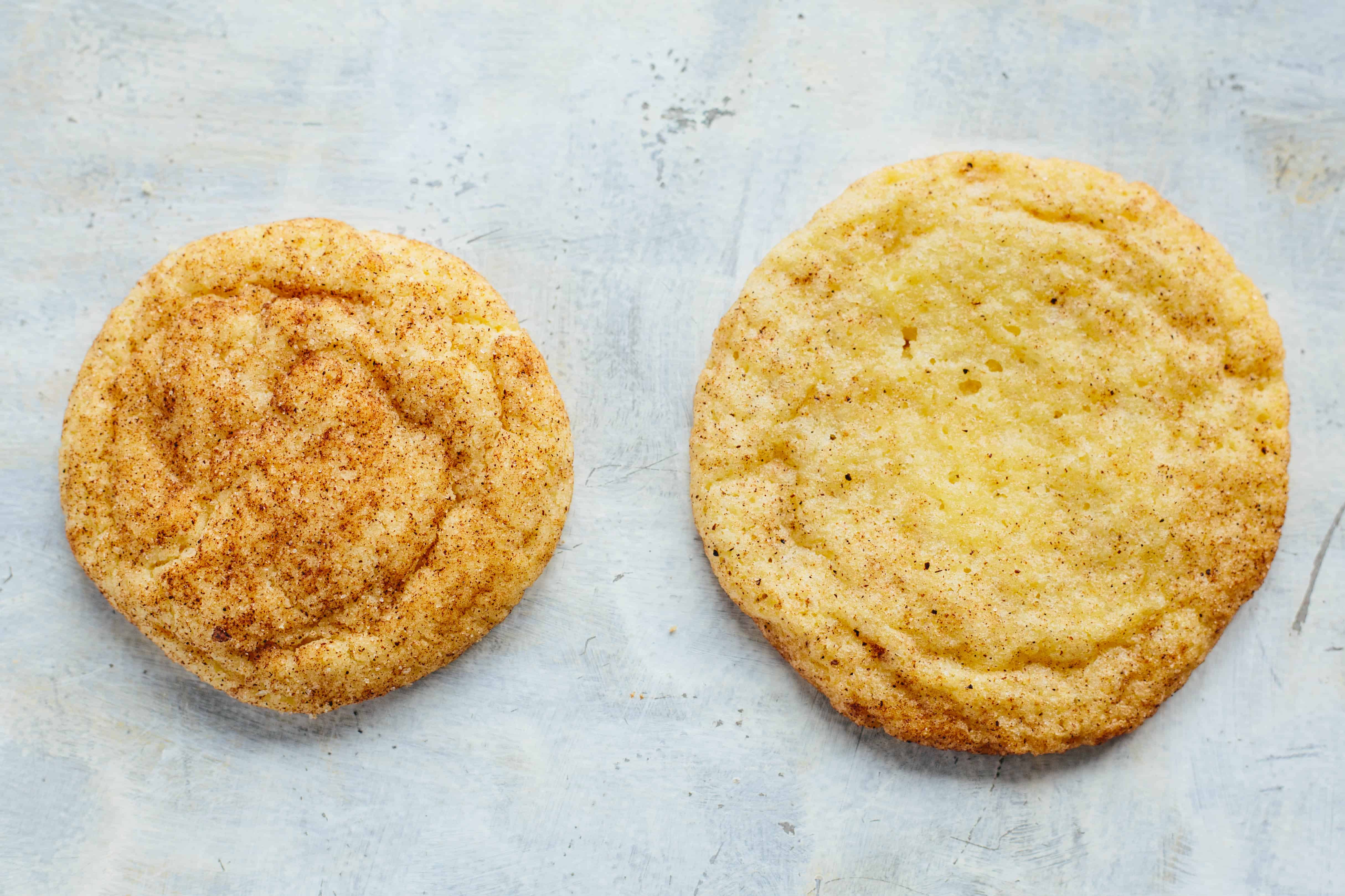 Close up top view of two chai snickerdoodle cookies.