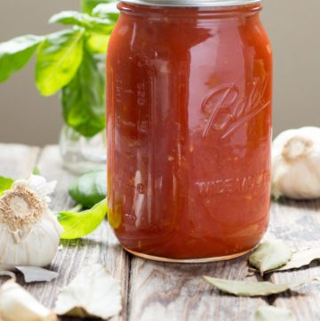 This easy + authentic Italian Marinara Sauce recipe is made from canned tomatoes and is a million times better than anything you can buy at the store! Takes less than 30 minutes to make and is perfect for tossing with pasta, topping pizza, chicken or eggplant parm, and more! #Italian #pasta #marinara #tomato #sauce #gravy #authentic | ColeyCooks.com