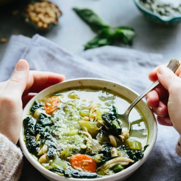 This 30 Minute Pesto Chicken, Kale + White Bean Soup is the perfect cozy recipe to whip up on a cold night when you want something healthy and easy. Gluten free, fresh and delicious! #easy #chicken #soup #recipe #pesto #beans #kale #healthy #glutenfree | ColeyCooks.com