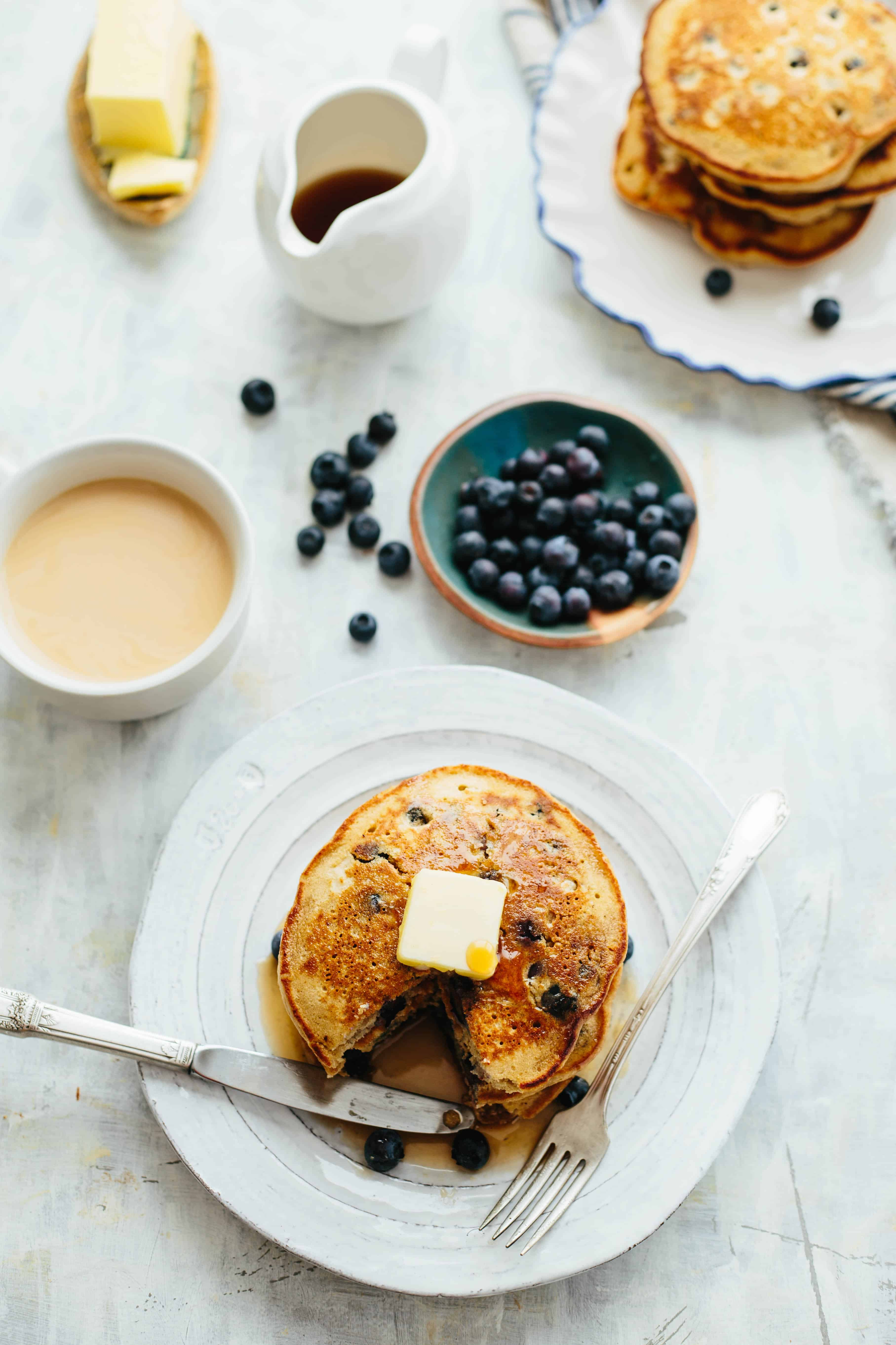 These blueberry oatmeal pancakes are light, fluffy, gluten free, dairy free optional, loaded with fresh juicy blueberries and taste absolutely delicious! #glutenfree #oatmeal #blueberry #pancakes #easy #breakfast #recipe #healthy | ColeyCooks.com