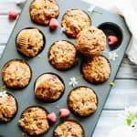 A dozen Paleo orange raspberry muffins baked in a muffin tin.