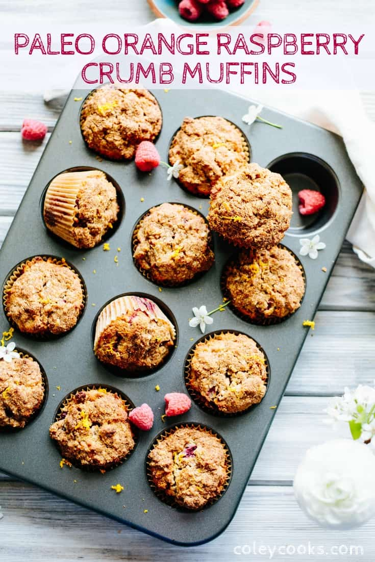 Muffin tin filled with baked Paleo orange raspberry crumb muffins.