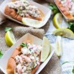 Lobster rolls in paper food trays.