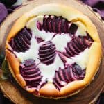 Overhead shot of finished ricotta cheesecake with plums