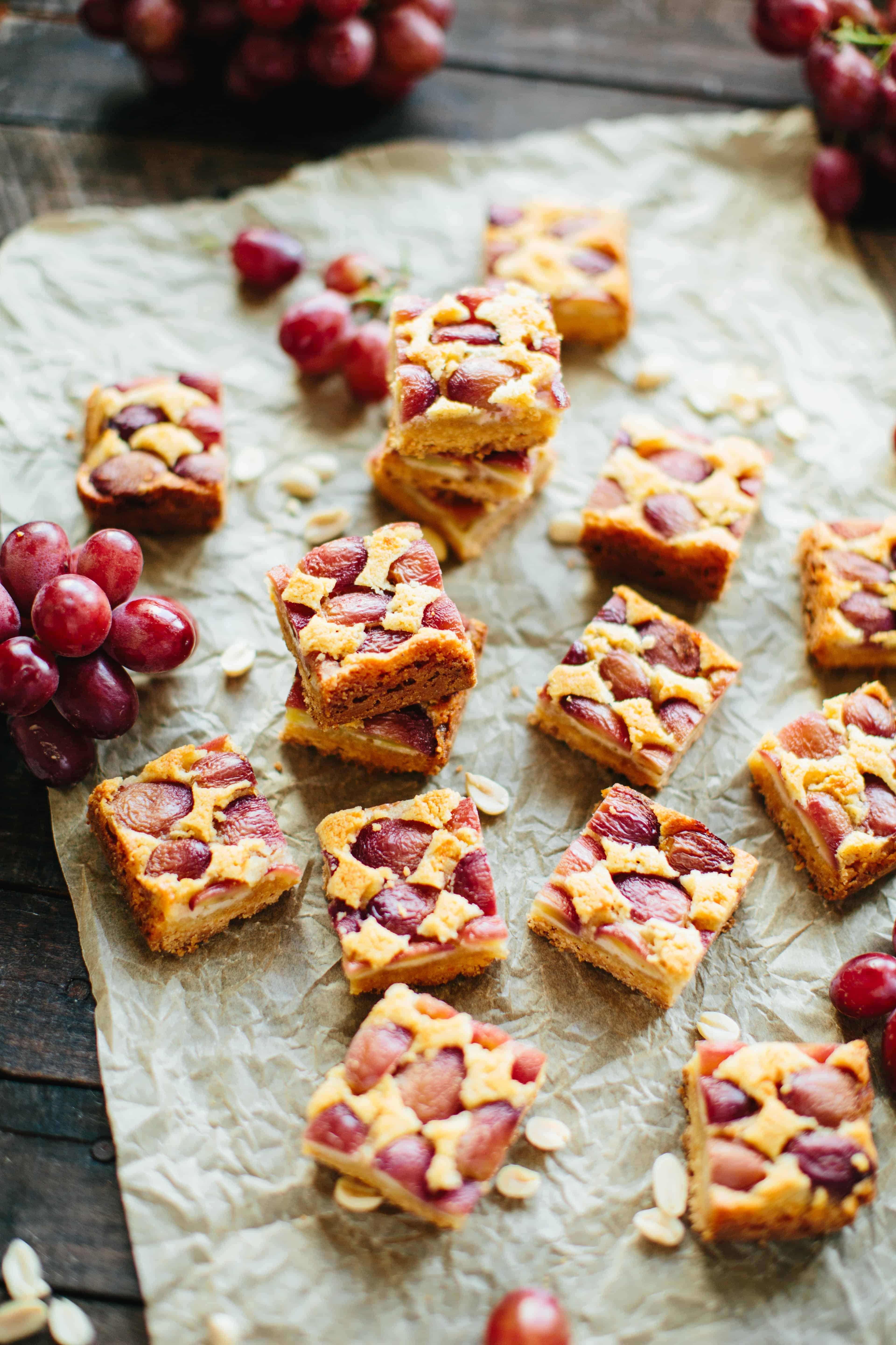 Buttery Shortbread bars with creamy peanut butter frangipane and sweet, juicy grapes! A surprisingly easy and unique treat that's gluten free optional. #easy #shortbread #bars #peanutbutter #grapes #recipe | ColeyCooks.com