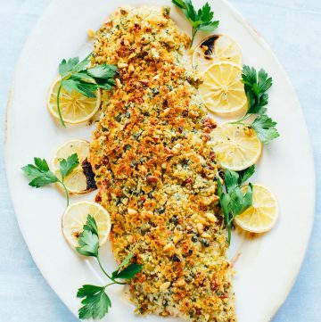 Whole Sicilian baked salmon on a platter