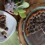 Top view of maple berry clafoutis with a slice removed to a plate.