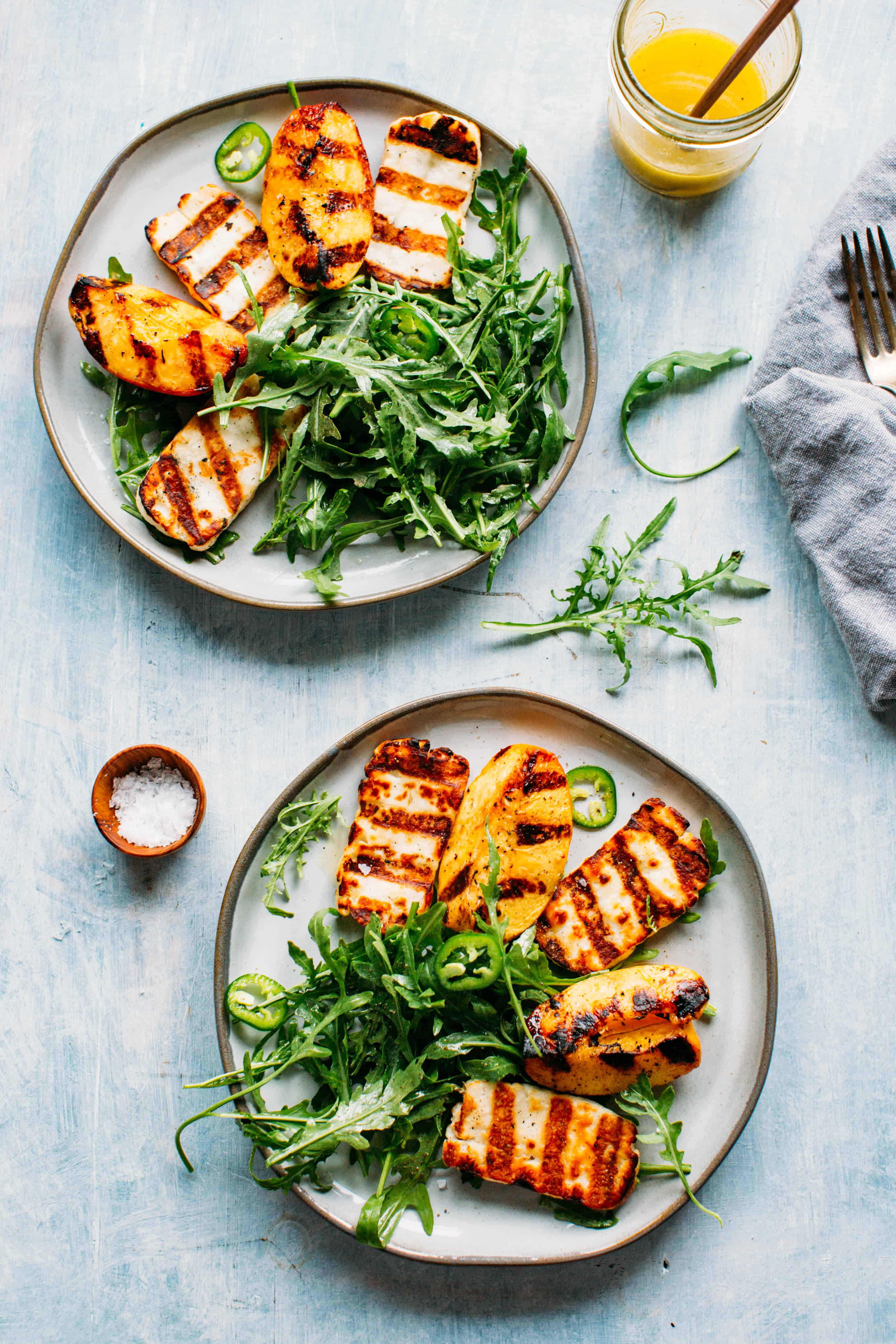 Grilled Halloumi Peaches With Arugula Jalapeños And A Honey Lemon Vinaigrette Coley Cooks