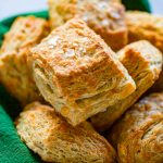 basket of biscuits with green napkin