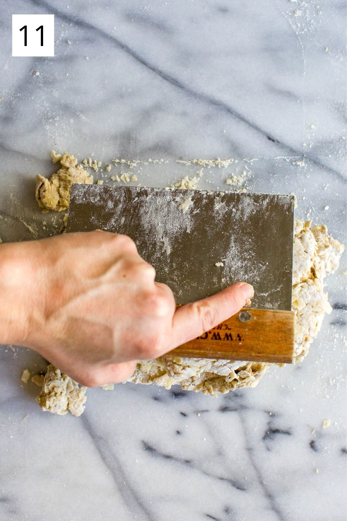 folding dough with scraper