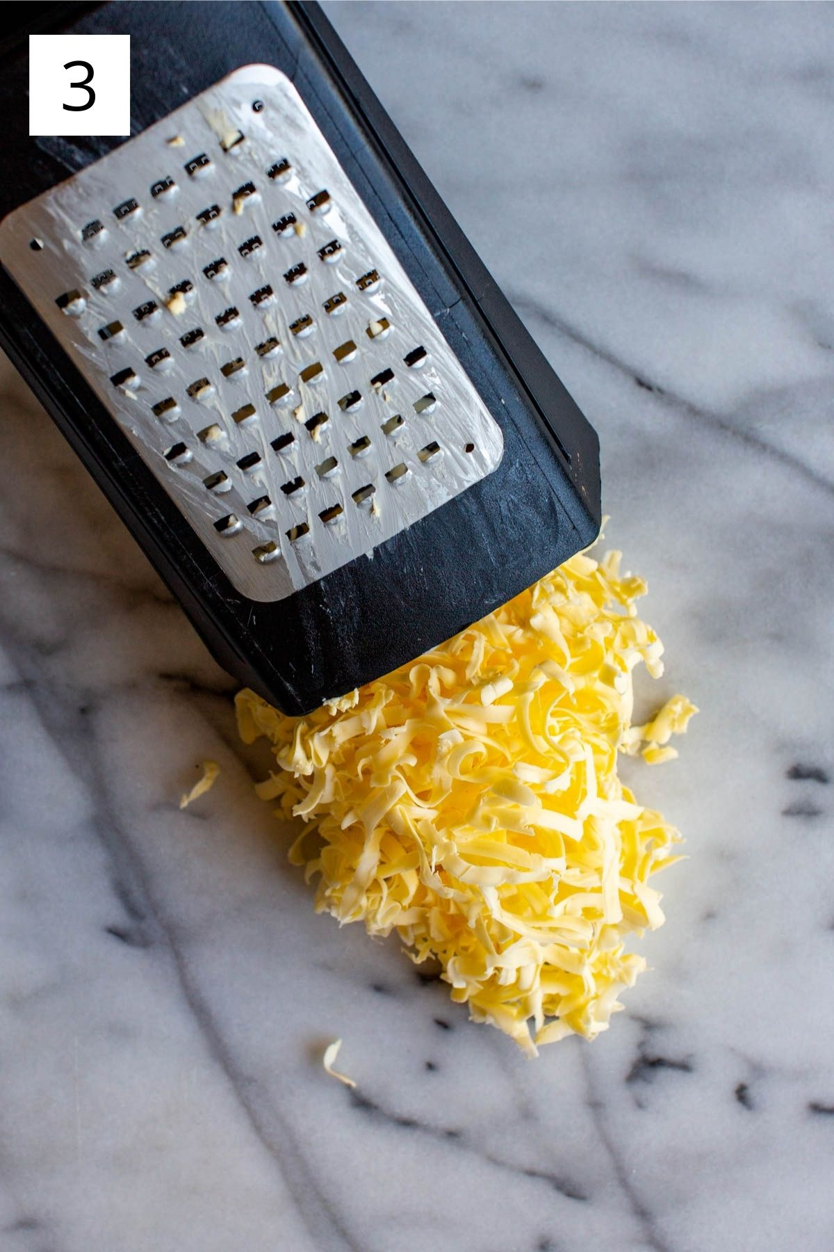 frozen butter grated on a box grater